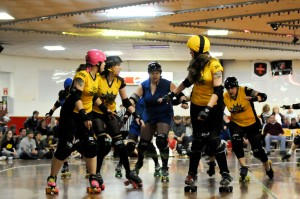 An April match pitted members of the B-Unit (yellow) against a team from Ithaca, N.Y. Photo courtesy of Steel City Derby Demons, taken by Steven Dalton
