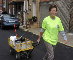 South Side resident Meg Burkardt heads out with a wagon full of supplies to clean up graffiti. This is Burkhardt's second time out with Graffiti Watch. Photo by Evan Skowvron | Point Park News Service