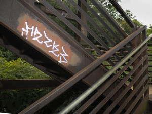 Graffiti covers the 15th Street Bridge on the South Side near Carson Street. Much of it is on top of what Graffiti Watch has previously cleaned up.  Photo by Evan Skowvron | Point Park News Service