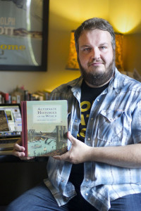 Matthew Buchholz shows his new book, Alternate Histories of the World. He will be having a book signing and trunk show at Wildcard on October 12. All proceeds from the trunk show will go to Animal Friends, a no-kill rescue center. Photo: Rachel Stellhorn | Point Park News Service