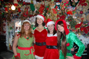 Spirit of Christmas volunteers prepare for a fundraiser at Bob's Garage. From left, Heidi Corwin, Norma Marencik, Melissa McKown, who is also a bartender, and Geneva King, a server. Photo by Emily Balser, Point Park News Service.