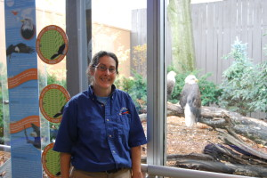 Christa Gaus, eagle trainer at the National Aviary on Pittsburgh's North Side, stands in front of the bald eagle exhibit at the aviary. Photos by Emily Balser.