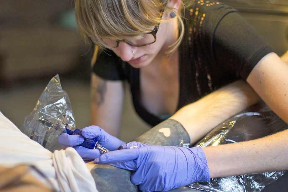 Female Tattoo Artist At Work