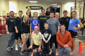 Lyneil Mitchell (cetner with glasses) takes a break with patients and staff at Revolution Physical Therapy in Cranberry Township. Photo: Submitted.