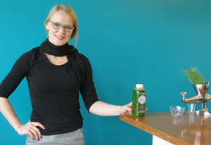 Owner Naomi Homison, inside The Pittsburgh Juice Company, holds a a bottle of the company's Green Juice. Emily Balser   Point Park News Service