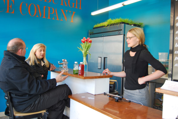 Owner Naomi Homison (right) talks with customers Thea Martin and Constantine Palrouras inside The Pittsburgh Juice Company. Emily Balser   Point Park News Service