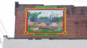 A sign representing Monessen's past hangs high on the side of the Monessen Historical Society so that vandals won't cover it with graffiti. Holly Tonini / Point Park News Service