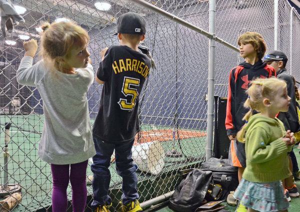 Kids check out the Pirates batting cages during a free tour of PNC Park on Sept. 24, 2014. Photo: Haley Wisniewski | Point Park News Service