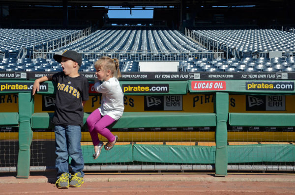 Carson and Maisie Beard hang outside of the Pirates dugout during a free tour of PNC Park on Sept. 24, 2014. Photo: Haley Wisniewski | Point Park News Service