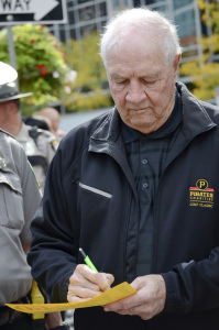 Former Pirate Bob Friend signs his autograph for a fan after the rally in Market Square on Sept. 30, 2014. Photo: Haley Wisniewski   Point Park News Service