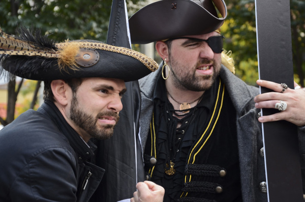 """First Mate"" Jeff Walters and ""Captain"" Chris Miller give their best pirate snarls at the playoff rally held in Market Square on Sept. 30, 2014. Photo: Haley Wisniewski 