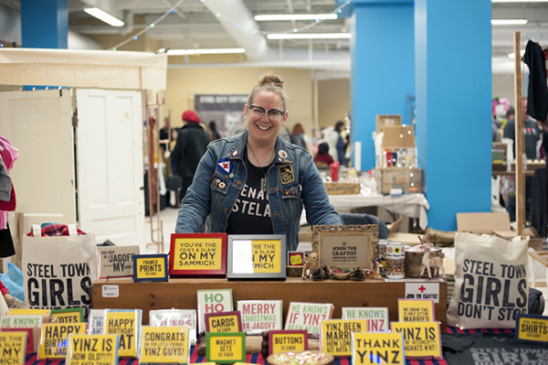Alethea Okonak, owner of John the Craftist, sells her Pittsburghese cards at the I Made It! market Downtown on Nov. 28, 2014. Photo: Sarah Collins   Point Park News Service