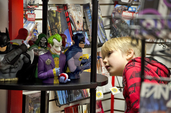 Caden Standiford looks at the comic-book character figurines at Big Bang Collectibles and Comics in Sewickley.<br /> Photo: Haley Wisniewski | Point Park News Service