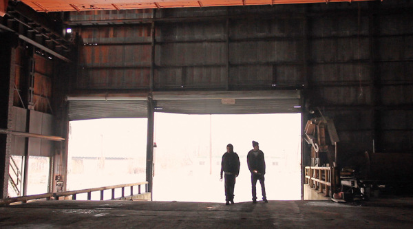 """Pavel Gaydos (left) and Alex Abramson approach the gateway of LTV Steel Mill in the music video """"The Calm."""" Photo: Carey McKelvey 