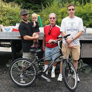 The winner of last year's bike donated by West Newton Bicycle Shop are featured above. Pictured L to R: Owner of  West Newton Bicycle Shop Floyd Marcheska holding his daughter, Gil Collie - 2014 bike winner and Westmoreland Yough Trail Chapter President Bruce Souply. Photo Courtesy of Bruce Souply
