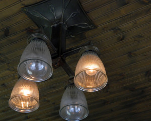 One of the original light fixtures from a trolly car. Photo by Jessica Federkeil, Point Park News Service.