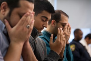 Harris Khan, center, 15, of Murrysville, prays for the victims of the San Bernardino, Calif., shootings at Al-Nur Mosque in Wilkinsburg in December 2015. The Ahmadiyya Muslim Community Pittsburgh held a prayer vigil to remember the victims and their families, while denouncing violence and extending a welcome to the community to visit their mosque. Stephanie Strasburg, Tribune-Review.