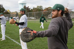 International player Richard Perez gets ready to throw the baseball to one of his teammates during warmups. Photo credit: Chloe Jakiela, Point Park News Service