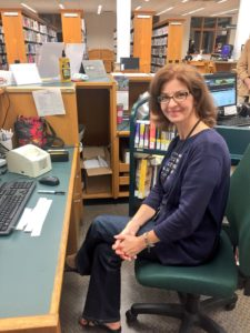Brynn Gminder works cataloguing books after casting her vote at the Northern Tier Regional Library.